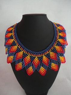 Gorgeus handcraft necklace by natives from Colombia. They only use czech blends, thread and their imagination . Mexican Jewelry, Southwest Jewelry, Fabric Origami, Handmade Necklaces, Beaded Necklaces, American Indian Jewelry, Beaded Crafts, Native American Beadwork, Beaded Collar