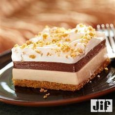 Creamy Peanut Butter and Chocolate Layered Dessert from Jif® will have your holiday guests coming back for seconds of dessert!