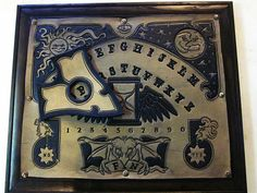 hand carved leather spirit board by Leatherheads on etsy