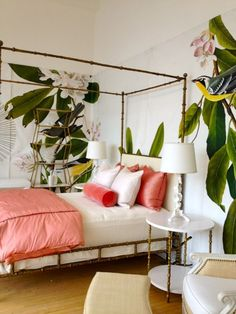 Beautiful bedroom with Faux-bamboo bed and table, foliage wall paper.