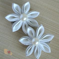 This set of elegant 7-petal Kanzashi Flower Hairclips is part of our White Edition, where it is all in the details of the white-on-white cloth.  Silver and white petals are arranged in a double layer design with a half-pearl in the center. Each flower is attached to a silver crocodile-clip.  ...