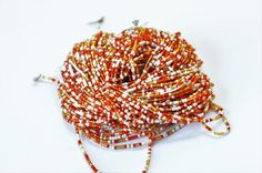 Waist beads- red, white, light brown waist beads, African belly beads, African jewelry, Ethnic jewelry, African beaded waist beads #LightBrownBeads #BodyJewelry #BeadedWaistBead #AfricanBeads #BeadedWaistBeads #SeedBead #BellyBeads #AfricanSeedBeads #AfricanJewelry #SeedBeads