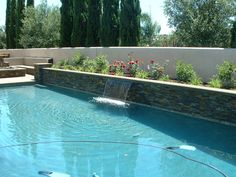 pretty stone for pool ledger wall  2' raised wall with 4' shear decent and stacked quartzite ledger panels.