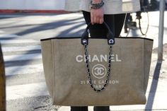 Chanel tote doubles as a beach bag! :)
