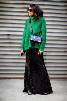 emerald green sweater, green sweater and long black sequined skirt, maxi skirt in sequins, Prada cross body bag, a green and black color combo outfit,