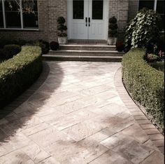 This beautiful entryway was created by A Plus Concrete using pavingstones by Cambridge Pavers with Armortec.