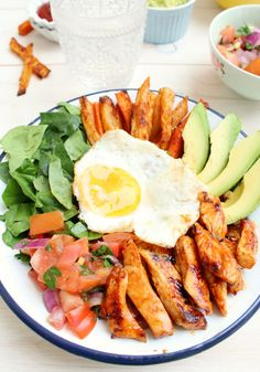 "Serves two, so this is a great date night dinner!  Mexican Paleo Super Food Bowl - chicken, avacado, carrot and sweet potato ""fries"", romaine lettuce, pico de gallo and a fried egg."