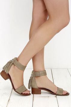 With a charming block heel, the Steve Madden Darcie Taupe Suede Leather Heeled Sandals excel at casual-chic! Genuine suede shapes a wide toe band and zippered heel cup with tasseled pull. Ankle strap has a bit of elastic for fit.