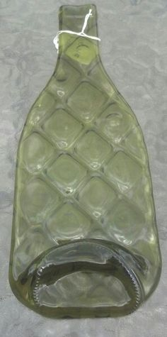 Wine bottle slumped on texture mold for a cheese tray