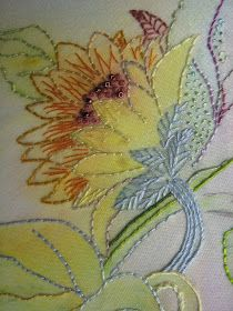 Watercolor on fabric and then embroidery on it using the color background