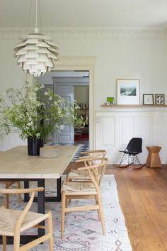 Wishbone chair by Hans Wegner from Carl Hansen & Søn and Artichoke pendant by Poul Henningsen from Louis Poulsen