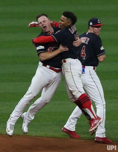 Cleveland Indians Francisco Lindor (C) leaps into the arms of teammate Jay Bruce with Bradley Zimmer standing nearby after defeating the… Cute Baseball Players, After Game, Indians Baseball, Lindor, Baseball Pants, Cleveland Indians, New York Yankees, Celebrity Photos, Jay