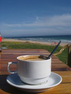 the best coffee is enjoyed early morning at the beach