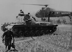 Operation Starlite 1965. A MAG-16 helicopter evacuates STARLITE casualties, while a Marine M-48 tank stands guard. The Marine on the left carries a M-79 grenade launcher.