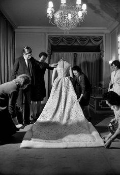 Yves Saint Laurent putting the finishing touches on Farah Diba's wedding dress, 1959.