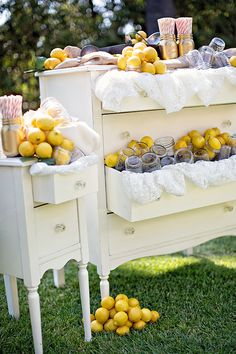 lemonade stand... It would be cute with peaches since I want my wedding at a peach orchard..