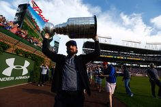 Patrick Sharp hoists the Stanley Cup at Wrigley Field.  #StanleyCup
