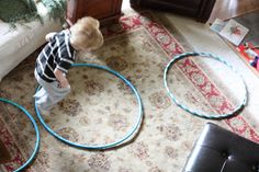 I bought three hula-hoops at the dollar store a few days ago and the first thing Big Brother did when we brought them in the house was to lay them out and