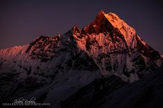 Chiaroscuro on Machapuchare (altitude - 6993m) sacred mountain of the Himalayas. Forbidden ascension by the Buddhist community. Taken from the Annapurna base camp inside the Sanctuary. by Julien Brebion Himalayan photographer