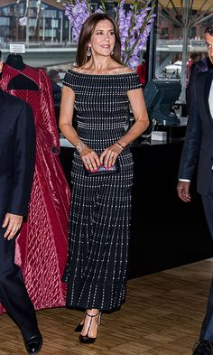 Crown Princess Mary wore a graphic motif dress for a concert at the Royal Playhouse with husband Crown Prince Frederik and Japan's Crown Prince Nahurito on June 16. <br><p>Photo: MARTIN SYLVEST/AFP/Getty Images