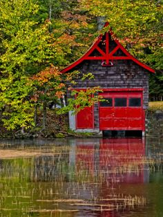 Old Forge. Red Boathouse on Lake Shore, New York, Usa