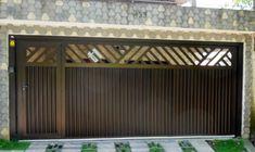 Portão em alumínio com pintura anodizada automático e portão social incluso.