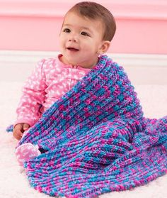 The Speedy One-Row Baby Blanket is the perfect blanket to knit while doing other things such as talking with friends, watching TV, or listening to an audiobook. This free knitting pattern for babies is cute, soft, and cuddly. Before you know it, you'll have a precious knit blanket for your baby.