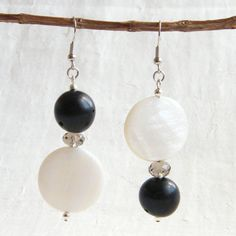 Brazilian Macauba Seeds, Grey Czech Crystals and Beautiful Mother of Pearl Pucks Statement Earrings via LauraBijoux. Click on the image to see more!