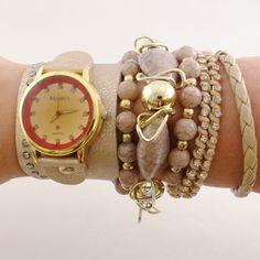 Relógio com Pulseira Dourada.    www.relogiosdadora.com.br