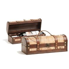 Single Treasure Map Wine Box Our single bottle Treasure Map wine gift box has old world charm. It comes with an aged wood finish, brass accents, luggage straps and an antique map design. An excellent accessory for any history or travel aficionado! * Wood and faux leather * Brass buckle * Wood bottle insert Dimensions: 4.72 x 12.80 x 5.00
