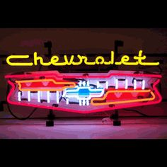 "CHEVROLET GRILL NEON SIGN-NN5CHGRL  28"" wide, 13""high, 4"" deep  Light up your garage with our Chevrolet Grill Neon Sign, featuring multi-colored, hand blown tubing supported on a black, finished metal grid. The Chevrolet Grill Neon Sign can be displayed flat on a wall or in a window or alternately be placed upon a shelf."