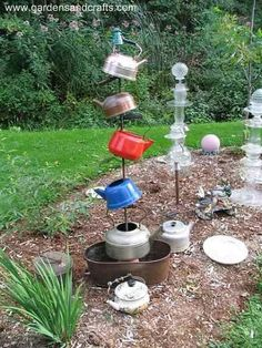 Cute garden sculpture from old teapots.