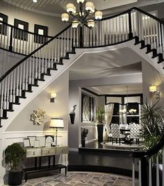 this grand foyer features 12-foot-high ceilings with a delicate