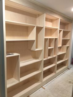 Hallway Tetris bookcase. Built ins are great. 11 ft total length. Creates awesome hallway library. Encourage kids to read by having places to keep lots and lots of books. We will have 20 feet of floor to ceiling bookcases in our hallway library, when fully finished.