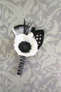 Anemone Wedding Boutonniere/Corsage. Follow #Labola.co.za for more tips and trends