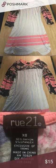 Floral quarter sleeve top It's an Xavier. Only been worn once. The sleeves are 3/4 sleeves and the middle is a little bit see through. Rue 21 Tops