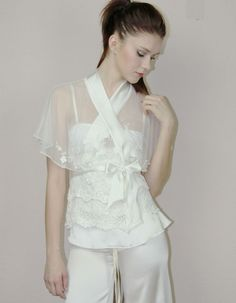 A lace bedjacket with flutter sleeves and silk bands and sash can be worn as outerwear, too!