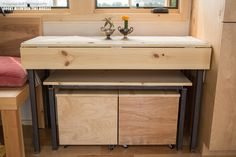 pequod-tiny-house-rocky-mountain-tiny-houses-3  Same system from a different view  If you wanted to use as a desk just pull out the bench and flip up one of the drop downs..
