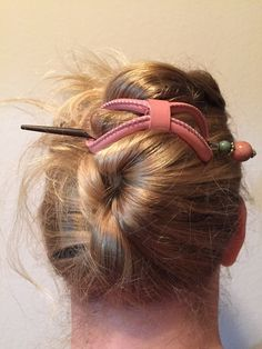 Carnation pink Leather 8 paired with the Teagan hair stick. Love how you can mix and match these accessories from Lilla Rose to go with your outfit, style, or mood!