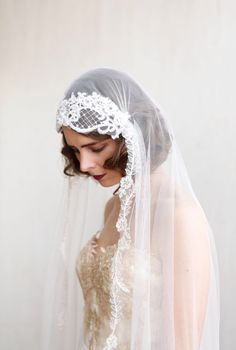 Statement Juliet Cap Veil with Lace,1920s style Ivory chapel length veil, Art Deco dramatic Wedding Veil, cathedral length veil by AgnesHart on Etsy https://www.etsy.com/listing/244318200/statement-juliet-cap-veil-with-lace1920s