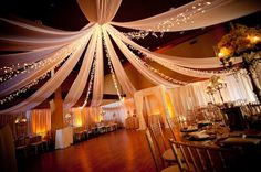 Twinkling lights and chiffon ceiling drapery creates a spectacular reception! Add floral candelabras and gold to really set the mood.  Photo by Atlanta Photo Studio.  Venue  - Lake Lanier Islands.