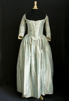 Robe à la polonaise, 1770s-1780s. Silk damask with scalloped stripes of heavenly robin's egg blue and ivory. The blue stripes have alternating patterns of small diamonds and window-pane plaid.