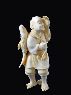 Description: Hand Carved Ivory Netsuke Figure measures 3 inches tall.