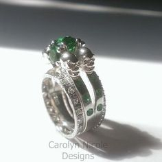 Skull Engagement Ring With Green Emerald Gems by Carolyn Nicole