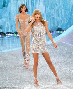 Flashback: Taylor performing at the Victoria's Secret Fashion Show in November 2013 - pictured with good friend Karlie Kloss walking behind her