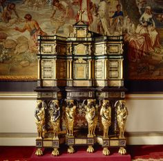 The pietre dure cabinet at Nostell Priory, Yorkshire. Paris, c. 1670. Certainly one of the most imposing pieces of furniture held by the Trust, is the pietre dure cabinet at Nostel Priory – and yet it is one of the least understood. Previously attributed to the Dutch ébéniste Pierre Gole, who supplied numerous pieces of furniture to Louis XIV of France. Sculptural wood carvings, tortoise and brass marquetry, the inclusion of hard-stone pietra paesina panels, gilt bronze mounts. -Nostell Priory- Royal Oak Furniture, Book Furniture, European Furniture, French Furniture, Antique Furniture, Furniture Design, Antique Curio Cabinet, Antique Cabinets, Art Cabinet