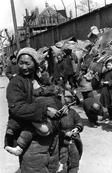 Refugee from the Chinese civil war. Shanghai 1949. Cartier Bresson.