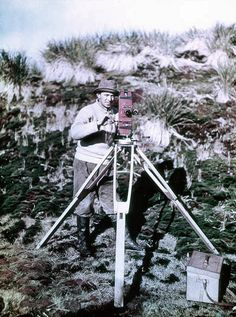 Frank Hurley with Cinematograph, 1915. Frank Hurley's famous early colour photographs of Sir Ernest Shackleton's ill-fated 'Endurance' voyage, as part of the British Imperial Trans-Antarctic Expedition, 1914-1917. Hurley was the official photographer on the expedition. Early in 1915, their ship 'Endurance' became inexorably trapped in the Antarctic ice. Hurley managed to salvage the photographic plates by diving into mushy ice-water inside the sinking ship in October 1915.