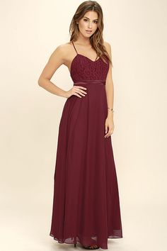 Steal the show as well as a couple smooches in the Stealing Kisses Wine Red Lace Maxi Dress! Elegant lace covers a triangle bodice (with princess seams) supported by adjustable, skinny straps. A band of satin accents the waist above a flowing, chiffon maxi skirt. Hidden back zipper/clasp.