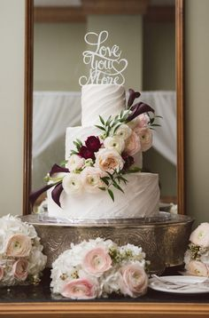 Ivory Wedding Cake with Ivory and Purple Roses and 'Love You More' Wedding Cake Topper on Silver Filigree Vintage Cake Stand